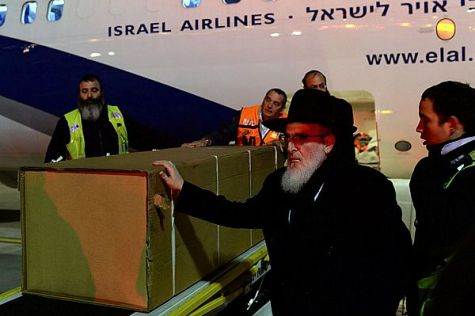 Coffins arrive at airport.