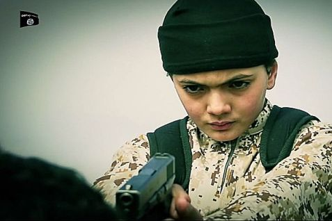 ISIS child aims gun at his victim as seen in ISIS video.