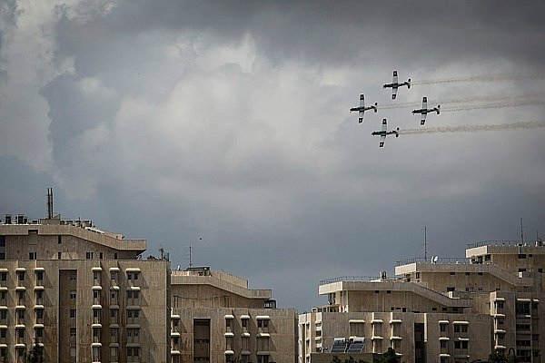 Israel Air Force planes fly over Jerusalem on Thursday, Yom Ha'Atzmaut.