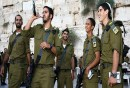 Israeli soldiers of the Golani Brigade blow the shofar at the Kotel.