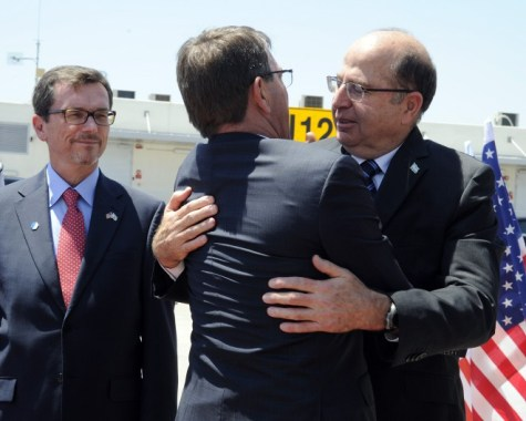 Israeli Defense Minister Moshe Boogie Yaalon (R) hugs with U.S. Defense Secretary Ash Carter before departing at Ben Gurion International Airport in Tel Aviv on July 21, 2015