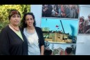 Orna and Hodaya Giat originally from Kfar Darom stand near photos of their Gush Katif community at a photography exhibition at an event marking 10 years to the Disengagement at the President's Residence in Jerusalem July 2015