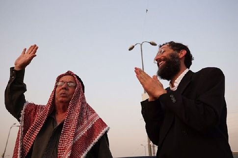 Jewish and Muslim bless a crowd of hundreds at a special prayer rally at Gush Etzion junction.