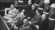 Defendants in the dock at the Nuremberg trials. The main target of the prosecution was Hermann Göring (at the left edge on the first row of benches), considered to be the most important surviving official in the Third Reich after Hitler's death.