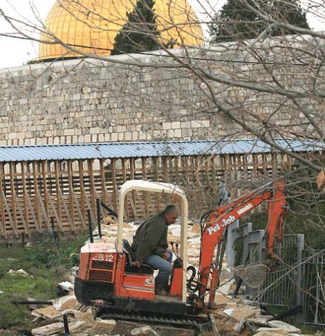 Arab digger breaks up a path on the Temple Mount