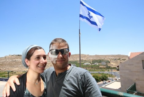 Shuki Gilboa with his wife Shlomit, in their Kiryat Arba home.