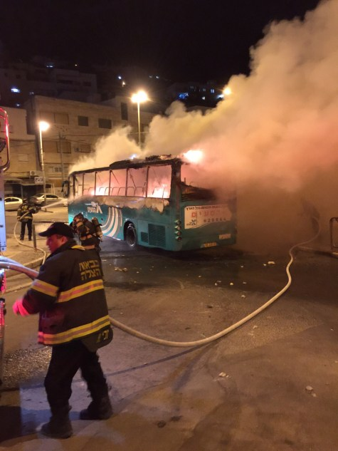 Jerusalem Fire Fighters putting out torched Egged bus in the Ras Al-Amud neighborhood.