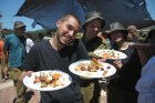 Combat Zone Cooking Competition: IDF base chef preparing and serving his unit's competition dish / Photo Credit: Gadi Yampel, IDF Spokeserson's Unit