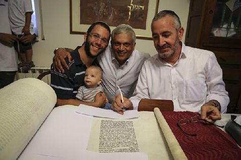 Inscribing the final words in the new Torah scroll as people perform the ceremony of bring the new Torah into the Nitvei Yochai Synagogue,  named after IDF Captain Yochai Klengel, z'l, who fell in the line of duty in an attack by Hezbollah along the border with Lebanon.