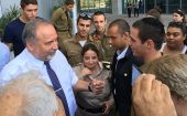 Defense Minister Avigdor Liberman welcomes IDF Lone Soldier Nissan Bloom to his sukkah.