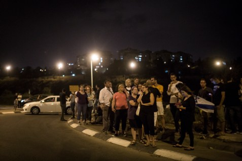 Residents of Jerusalem's Armon Hanatziv neighborhood protest at the traffic circle at the entrance Tzur Baher, where Alexander Levlovitz was murdered by Arab terrorists.