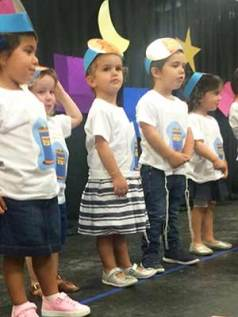 Children performing at Chai Tots Preschool end-of-year show.