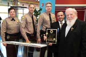 Rabbi Pinchas Weberman (far right) with members of South Florida law enforcement.