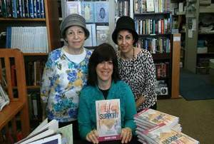 Rachel Stein (seated) at a book signing for Life Support. Left to right: Rena Naghi and her daughter Janet Afrah, owners of Judaica Corner in Atlanta, where the book signing took place.