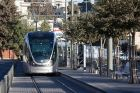 The Jerusalem Light Rail arrives at the Shuafat neighborhood in Jerusalem on September 16, 2014.