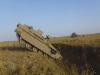"IDF Engineering ""Namer"" APC enters anti-tank trench."