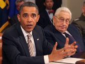 Pres. Obama seated with Henry Kissinger
