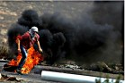Arab Palestinian protesters burn tires and throw stones at Israeli troops during clashes near Ramallah. In separate incidents on Oct. 13,  Jews were brutally attacked by Arab terrorists in Jerusalem. Three Israelis and two attackers were killed.
