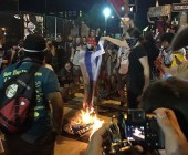 Protesters burning an Israeli flag at the DNC convention