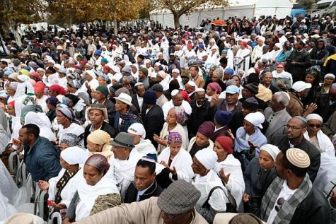 Thousands of Ethiopian Jews take part in a prayer of the Sigd holiday on the Armon Hanatziv Promenade overlooking Jerusalem.