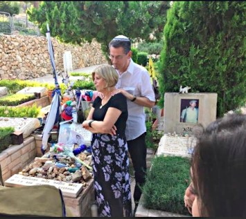 Michael Levin's parents at his grave on his 10th Yartzheit.