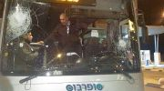 A SuperBus windshield is smashed in an Arab stoning attack.