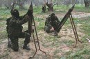 Hamas operatives launching rockets. (file)