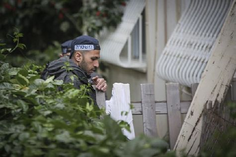 Israeli security forces search for the killer after a shooting attack at a pub in central Tel Aviv.