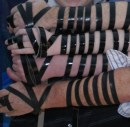 Grandfather, father and two sons wearing tefillin