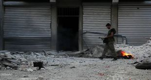 1024px-Free_Syrian_Army_soldier_walking_among_rubble_in_Aleppo