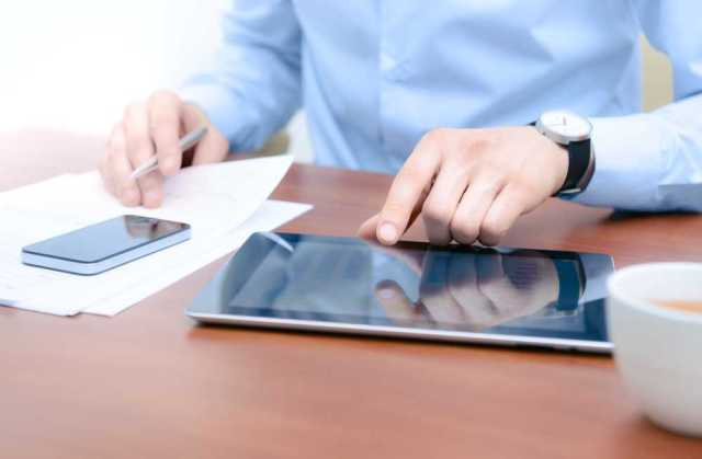 businessman-on-tablet