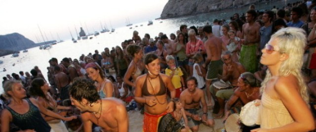 People dancing, Sunset beach party, Benirras Beach, Ibiza, July 2006. (Photo by: PYMCA/UIG via Getty Images)