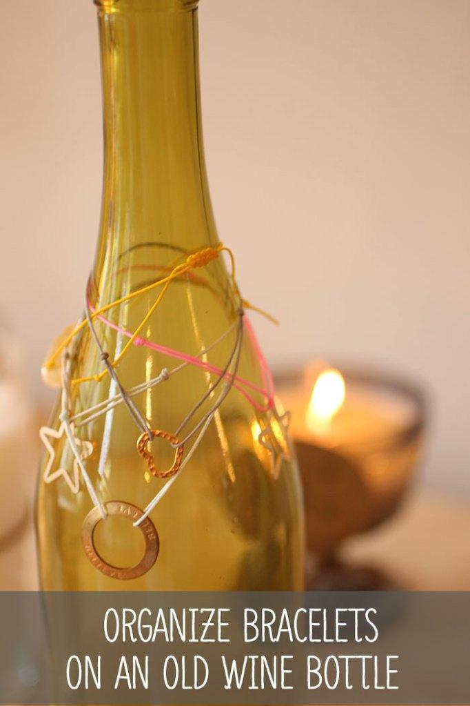 organize-bracelets-layering-on-wine-bottle