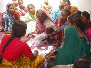 Birth attendants learn to sew gloves.