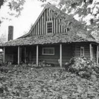 The log farmhouse.