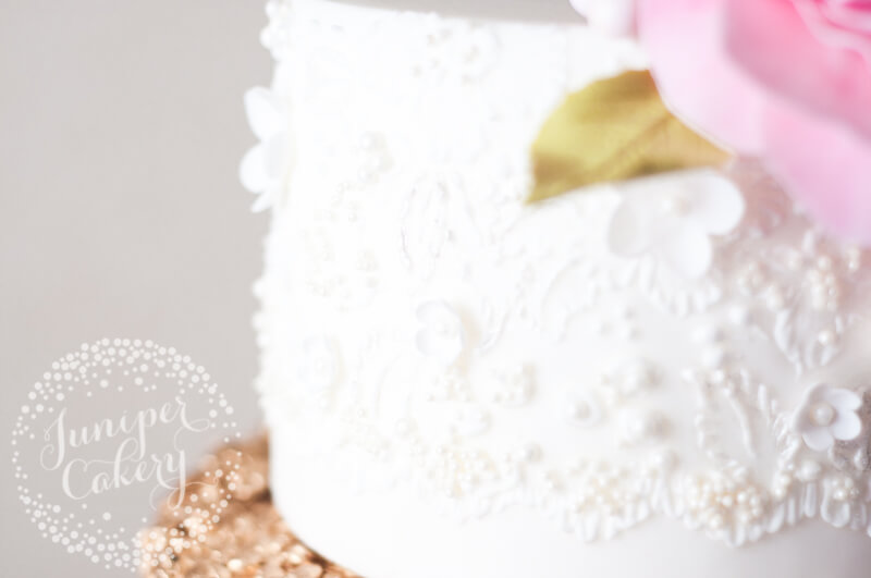Hand piped lace detail on wedding cake by Juniper Cakery