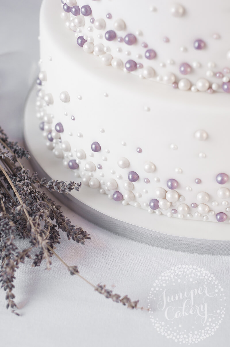 Ivory and lavender pearl embellished wedding cake by Juniper Cakery