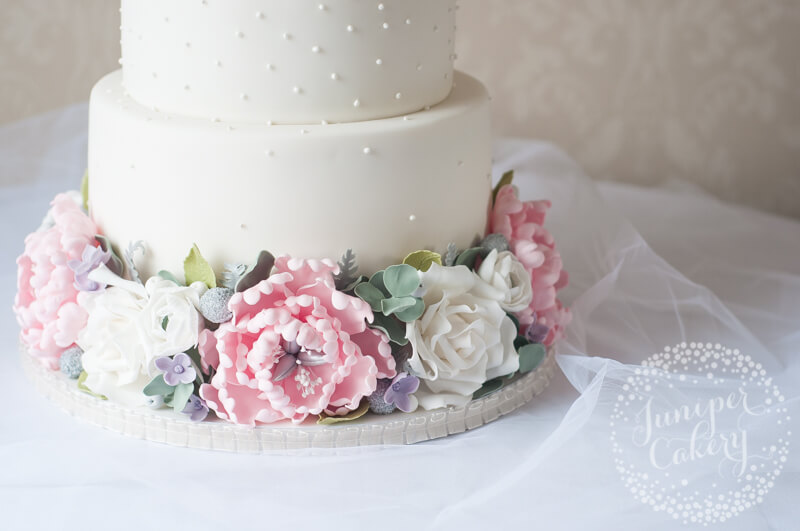 Pretty peony and rose wedding cake by Juniper Cakery