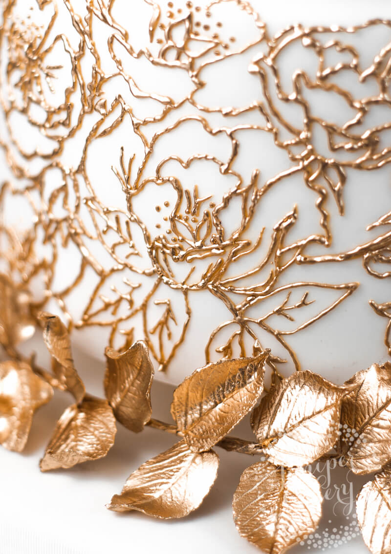Gold royal icing lace by Juniper Cakery