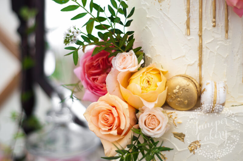 Fresh rose gold drip wedding cake by Juniper Cakery