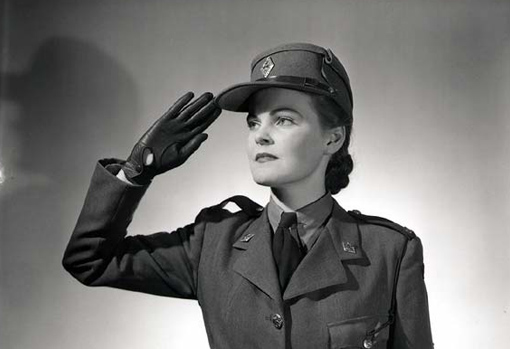 A CWAC saluting. In its public relations campaign, the Army stresses the positive aspects of serving in the Women's Corps, highlighting its members' professional activities, their confidence and charm. Ottawa, October 30th, 1943.