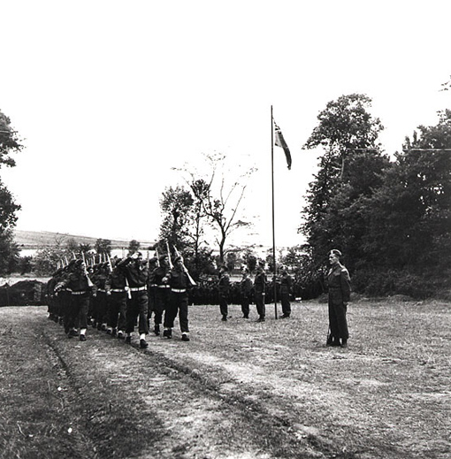 Unfurling of the Canadian Red Ensign at First Canadian Army HQ in Normandy, June 29th, 1944.