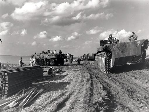 A column of Alligators passing Terrepin amphibious vehicles on the Scheldt River near Terneuzen, October 13th,1944.