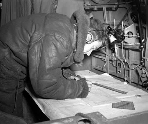 F/O Jack Ritchie, navigator, plotting course on a Sunderland.