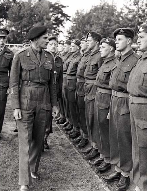 Lieutenant-General Guy Simonds inspecting II Canadian Corps in Meppen, Germany, May 31st, 1945.