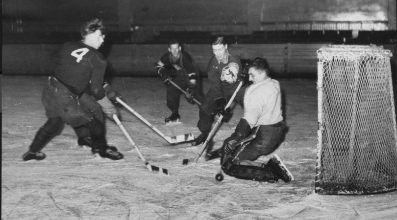 Royal 22e play hockey overseas.  Here's the goalie of the Royal 22e Regiment, Pte, Caron of Donnacona, Quebec.  He let the puck pass him four times in the four league games played by the Vingt-Doos. Hockey is a favourite sport with Canadian soldiers serving overseas. England, January 1943. 5DHH1123P1D953) Photo courtesy of Directorate of History and Heritage, Department of National Defense.