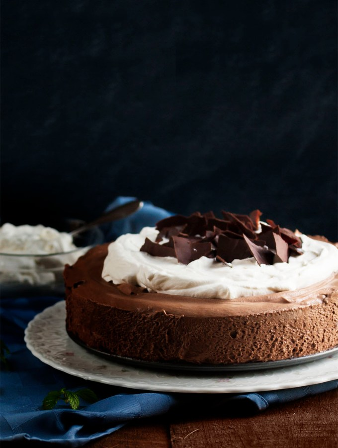 Dark Chocolate Mousse Pie - Dark chocolate whipped up into a creamy mousse layered over a crisp cookie crust and topped with mounds of whipped cream. Yum! | justalittlebitofbacon.com