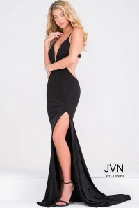 Black jersey open back high slit dress and plunging ...