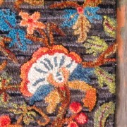Close up of the crewel work inspired hooking.