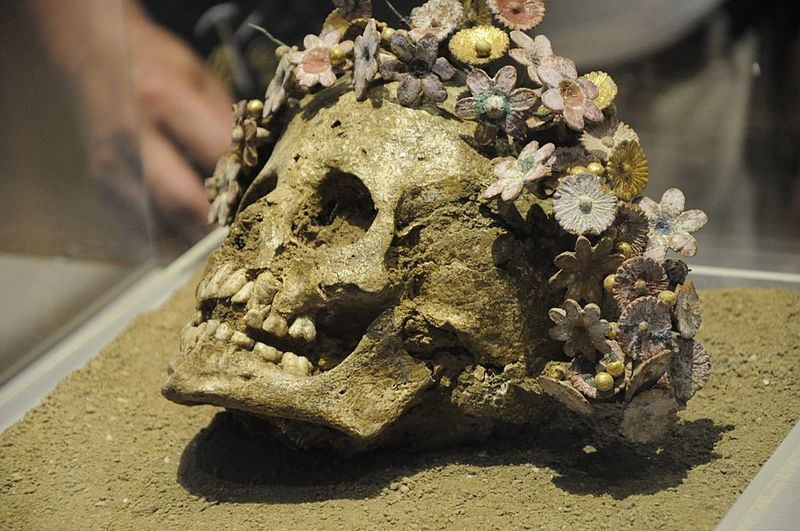 Girl buried with a crown of ceramic flowers. Patras, 300-400 B.C. From the Museum of Patras.